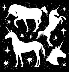 white unicorn silhouettes set with stars on black vector image vector image