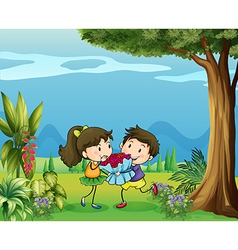 A boy giving a girl a bouquet of flowers vector image