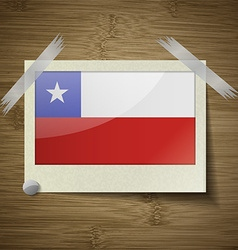 Flags Chile at frame on wooden texture vector image