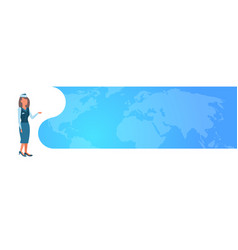 stewardess woman in uniform and hat pointing world vector image