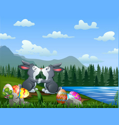 Easter bunnies kissing with eggs vector