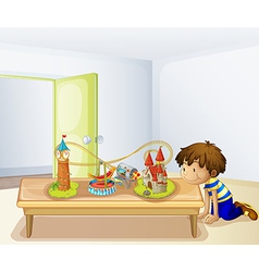 A boy looking at his toys vector image