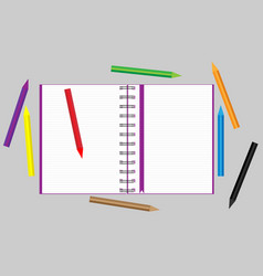 Open notebook with scattered colored pencils vector