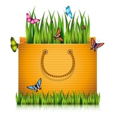Paper shopping bag with fragment of grass vector image