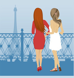 Two women look at the eiffel tower in paris vector