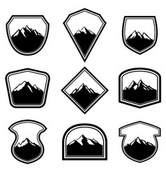 Set of empty badges with mountains design vector