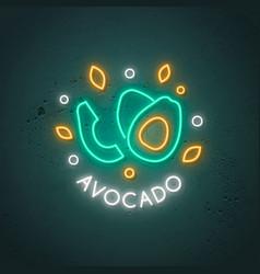 neon avocado sign glowing avocado fruit emblem in vector image