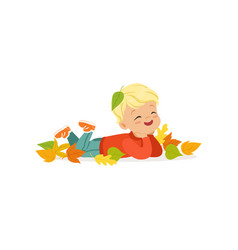 Cute little boy in warm clothing lying on the vector