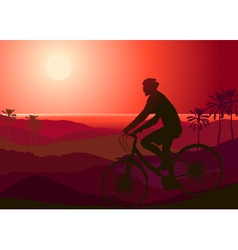 Mountain Biker Riding into the Sunset vector