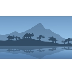 Silhouette of triceratops in the riverbank vector image