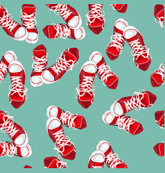 red sneakers on green background vector image