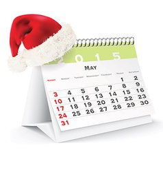 May 2015 desk calendar with Christmas hat vector