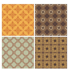 Four decorative symmetric seamless patterns vector image vector image