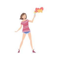 happy girl holding burning firecracker teenage vector image