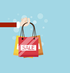 hand with shopping bag flat design vector image