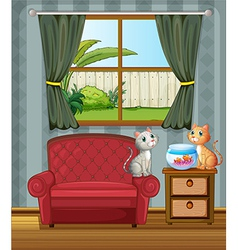 Two cats beside an aquarium vector image vector image