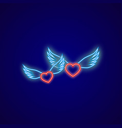 two neon hearts with wings on a blue background vector image