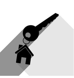 Key with keychain as an house sign black vector