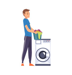 Man holding laundry basket while standing next vector