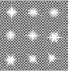 Set of glowing light bursts with sparkles o vector