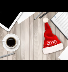 Christmas office background with santa hat tablet vector