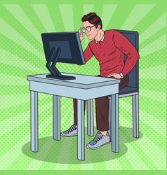 Pop art weak-eyed man working at the computer vector