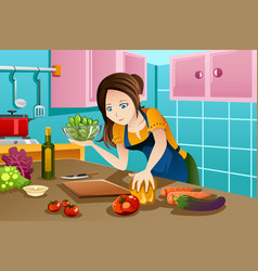woman cooking healthy food in the kitchen vector image