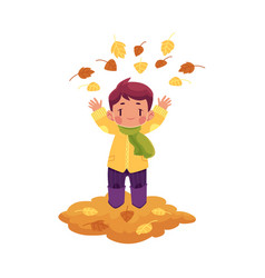 Boy throws autumn leaves up isolated vector