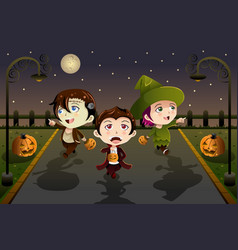 Kids wearing halloween costumes vector