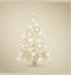 Christmas tree made from golden snowflakes vector