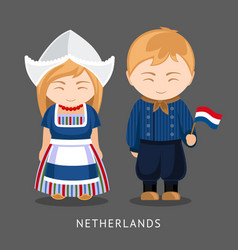 Dutches in national dress with a flag vector