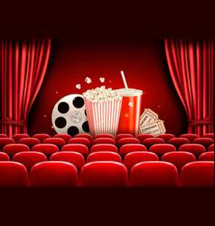 cinema background with a film reel popcorn drink vector image vector image