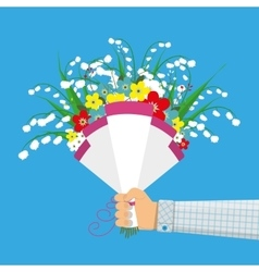 Cute bouquet of flowers in hand vector image