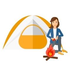 Woman kindling fire vector