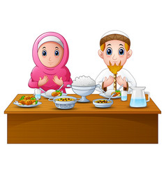 Muslim couple pray together before break fasting vector