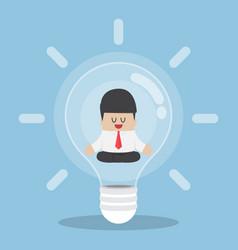 businessman doing meditation inside light bulb vector image vector image