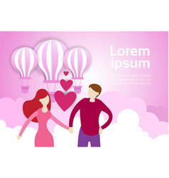 couple hold hands over air balloons in pink sky vector image