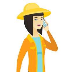 Young asian farmer talking on a mobile phone vector