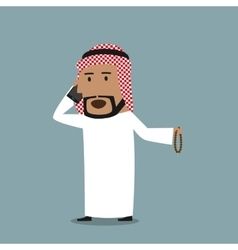 Arabian businessman talking on the mobile phone vector image