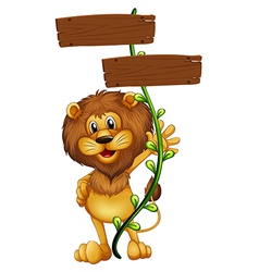A lion holding a sign board vector