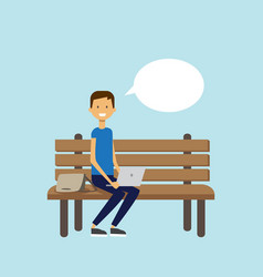 man using laptop sitting wooden bench chat bubble vector image