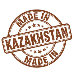 made in kazakhstan brown grunge round stamp vector image