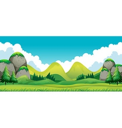 Scene of green field with mountains background vector image vector image