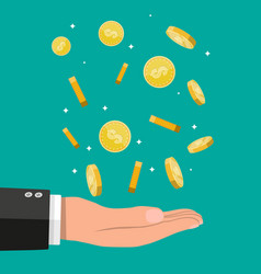 Buisnessman hand catching falling gold coins vector