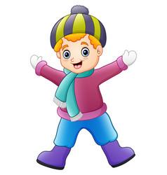 Happy boy wearing winter clothes vector