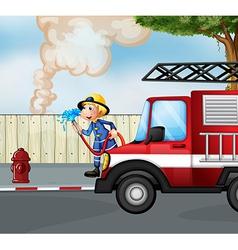 A fireman rescuing a fire near the street vector image vector image