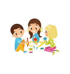 Cute little kids making figures from a plasticine vector