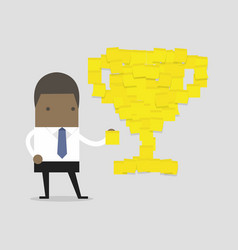 Businessman with trophy cup yellow sticky notes vector