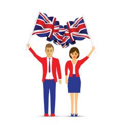 man and woman waving the uk flag vector image