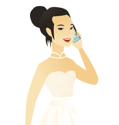 Young asian fiancee talking on a mobile phone vector